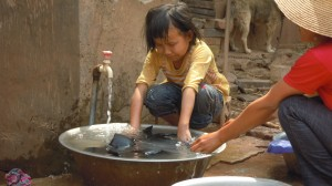 Villagers using water piped into homes
